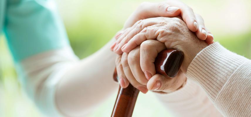 carer and older lady hands